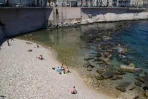 La spiaggia a rischio di privatizzazione